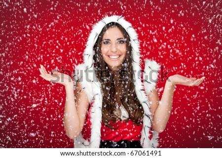 attractive santa woman enjoying the way it snows - stock photo
