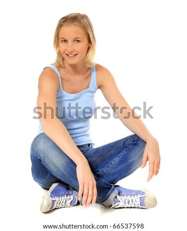 Attractive scandinavian girl sitting on floor. All on white background. - stock photo