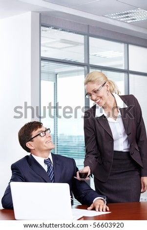 Attractive secretary brings coffee boss in the office - stock photo