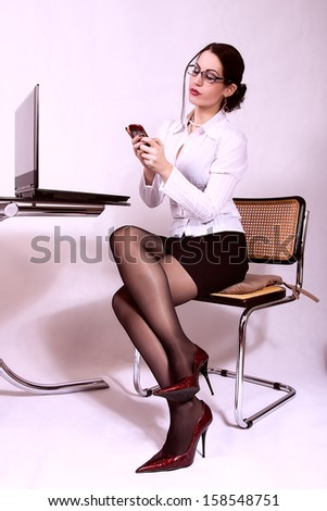 attractive secretary with eyeglasses. office background - stock photo