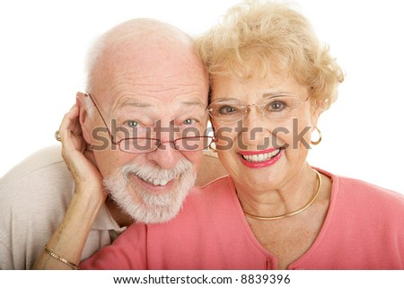 Attractive senior couple in modern, fashionable glasses.  Part of my optical series.  Isolated on white - stock photo