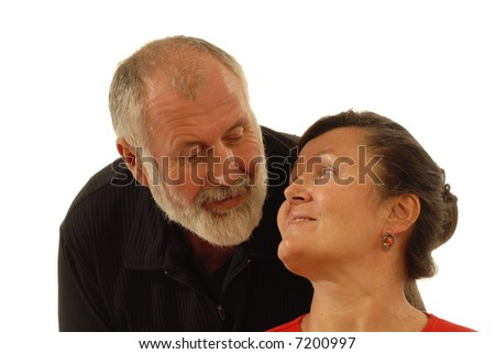 Attractive senior couple looking at each other tenderly; isolated on white