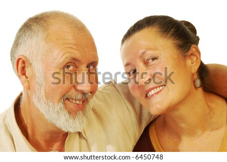 Attractive senior couple smiling; isolated on white