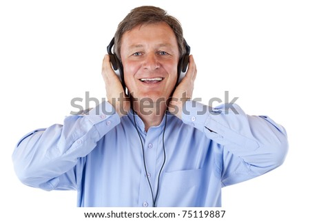 Attractive senior with headphones singing happy to mp3 music. Isolated on white background. - stock photo