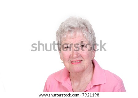 Attractive senior woman against a white background - stock photo