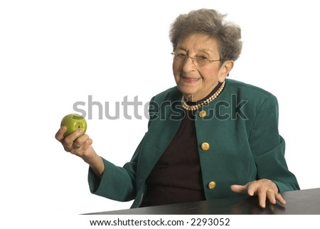 attractive senior woman business executive with pearls apple