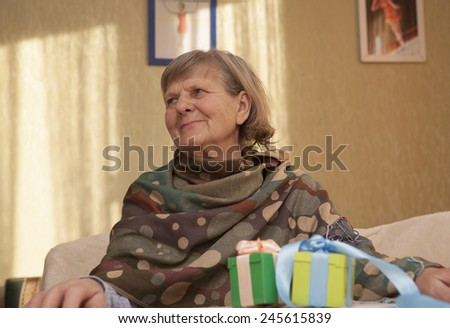 attractive senior woman looking away and smile, portrait - stock photo