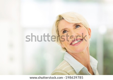 attractive senior woman looking up
