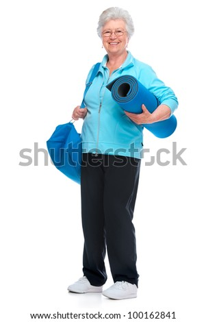 Attractive senior woman with a sports bag and mat - stock photo