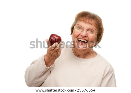 Attractive Senior Woman with Apple Isolated on a White Background. - stock photo