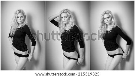 Attractive sexy blonde in black tight fit blouse and bikini posing provocatively . Portrait of sensual woman in classic boudoir scene against a wall. Beautiful fair hair female, indoor shot. - stock photo