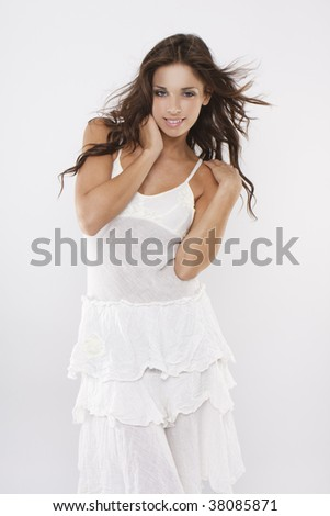 attractive sexy brunette girl wearing white dress on white background - stock photo
