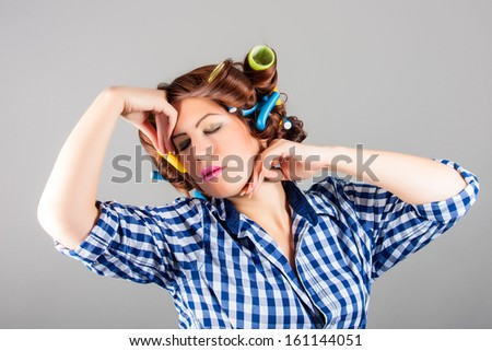 attractive sexy housewife with curlers - stock photo