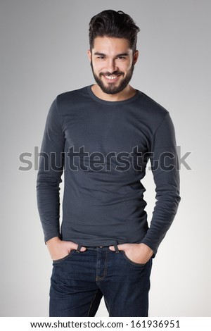 attractive sexy man with beard dressed casual smiling - stock photo