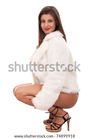 attractive sexy, naked girl wearing only fur coat - stock photo