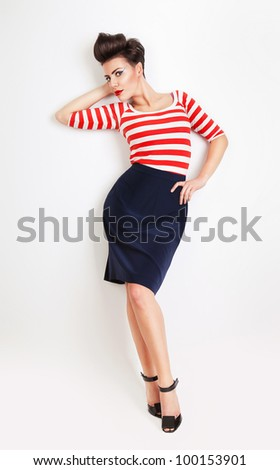 attractive sexy pinup woman in striped t-shirt at wall - stock photo