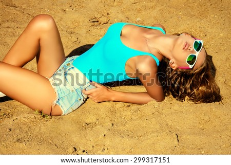 Attractive sexy tanned girl on the beach. Summer vacation.  - stock photo