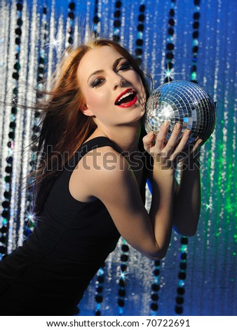 Attractive sexy woman clubbing, dancing in the disco and moving her hair - stock photo