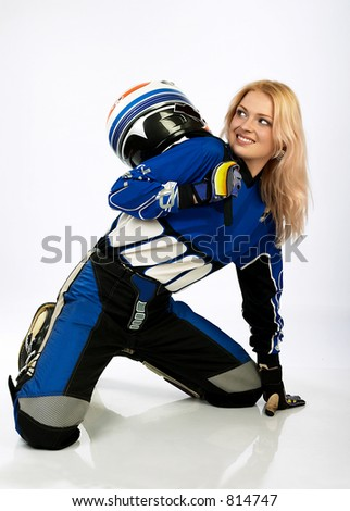 Attractive sexy woman in motoracer uniform.  More images of this attractive model and other one you can find in my portfolio. WELCOME!!! WELCOME!!! WELCOME!!! - stock photo