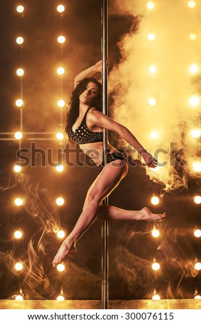 Attractive sexy woman pole dancer - stock photo