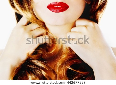 Attractive sexy young pretty healthy woman / model with fair complexion red lips holding long blond hair locks