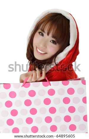 Attractive shopping girl in Christmas clothes showing smiling face. - stock photo