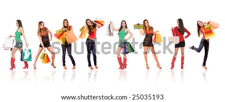 Attractive shopping woman with bags and gift box isolated on white. - stock photo
