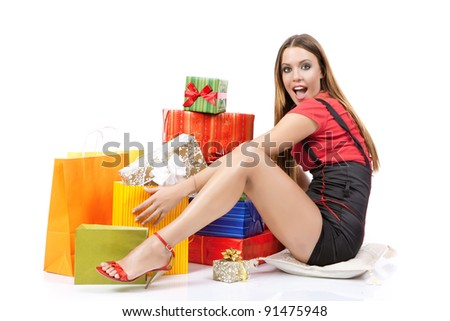 Attractive shopping woman with plenty gift box against white background. - stock photo
