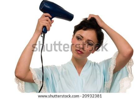 Attractive short hair brunette woman wearing a robe holding a blow dryer drying hair