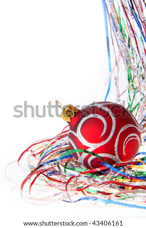 Attractive single christmas red ball among colored tinsel over white - stock photo
