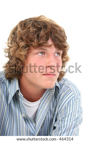 Attractive Sixteen Year Old Teen Boy in casual over white background.  Light brown curly hair and hazel eyes. - stock photo