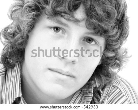 Attractive Sixteen Year Old Teen Boy in casual over white background.    Shot in studio over white. - stock photo