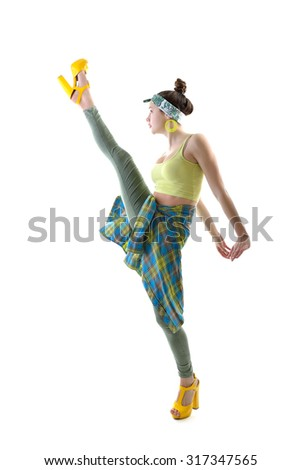 Attractive slim teen girl posing in studio. Full length portrait of young fashion woman. Fitness dancing girl. Steps like splits. - stock photo