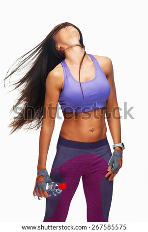 Attractive slim woman with dark long hair in action. Isolated on white - stock photo