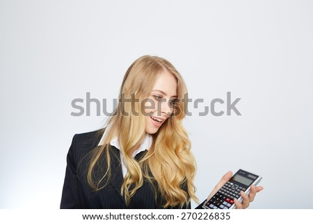 attractive smiling business woman with calculator isolated on white - stock photo