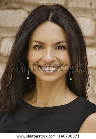 Attractive smiling business woman with long straight hair - stock photo
