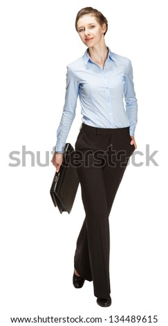 Attractive smiling businesswoman - full length portrait on white background - stock photo