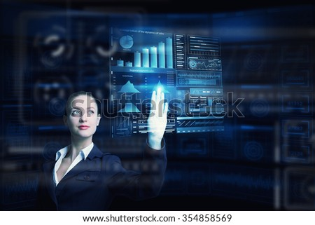 Attractive smiling businesswoman working with virtual panel interface