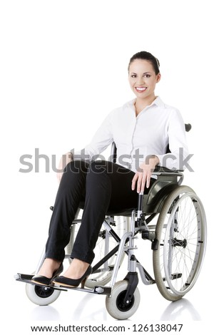 Attractive smiling disabled businesswoman sitting in a wheel chair isolated on white