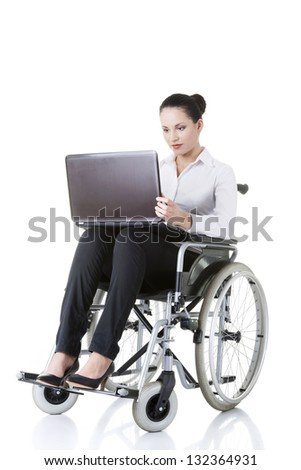 Attractive smiling disabled businesswoman sitting in a wheel chair isolated on white - stock photo