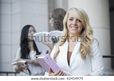 Attractive, Smiling Female College Student - stock photo