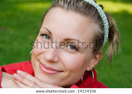 attractive smiling female in nature - stock photo