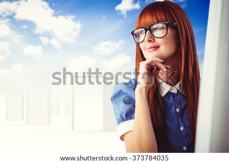Attractive smiling hipster woman thinking against opening door in sky - stock photo