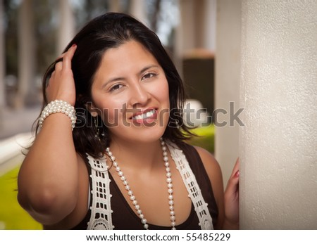 Attractive Smiling Hispanic Young Adult Woman Portrait Outside. - stock photo