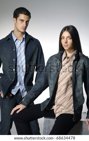 Attractive smiling mid adult couple shot in studio - stock photo