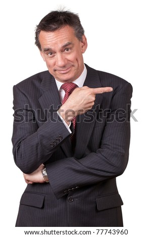 Attractive Smiling Middle Age Business Man in Suit Pointing Right
