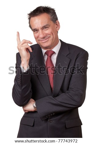 Attractive Smiling Middle Age Business Man in Suit Pointing Upwards