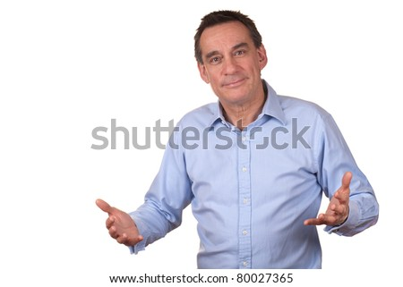 Attractive Smiling Middle Age Man in Blue Shirt with Raised Hands as though Talking