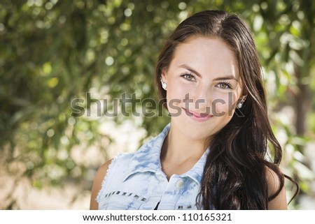 Attractive Smiling Mixed Race Girl Portrait Outdoors. - stock photo