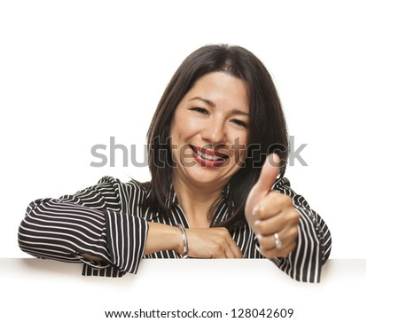 Attractive Smiling Mixed Race Woman Leaning on Blank White Sign with Thumbs Up Isolated on a White Background. - stock photo